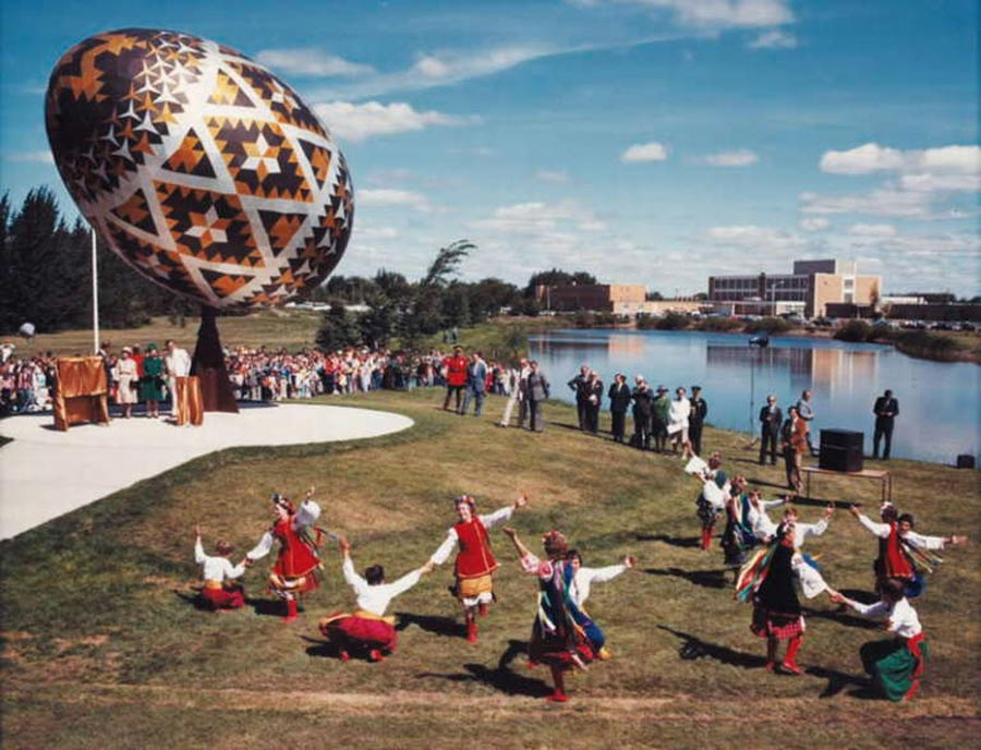 Canadian Ukrainians dancing under The Vegreville Egg, a giant pysanka (Ukrainian-style Easter egg) in Vegreville, Alberta, Canada.