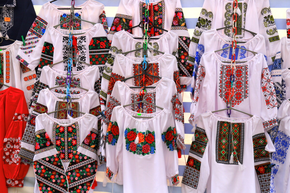 Beautiful Ukrainian ethnic embroidered shirts, vyshyvanka, hang at the fair at the festival on the Independence Day of Ukraine, Dnipro city.